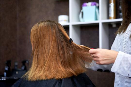 Barber cuts a girl's hair