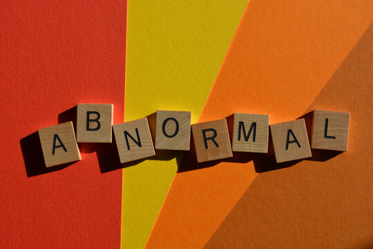 Abnormal, word in wooden alphabet letters isolated on colourful background