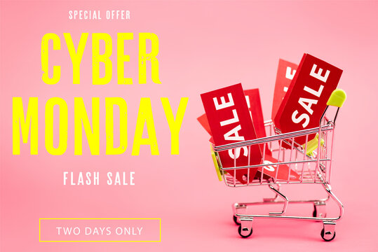 red labels with sale in small shopping trolley near special offer, cyber monday lettering on pink, stock image