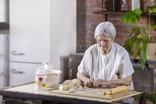 Senior woman preparing pastries in the kitchen at home