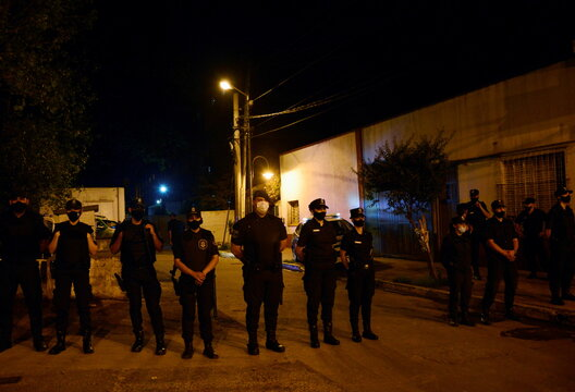 Police stand guard outside the morgue where the body of soccer legend Diego Maradona is being held, in Buenos Aires