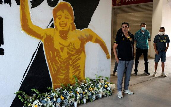 President of Dorados de Culiacan soccer club Nunez speaks next to a mural showing late Argentine soccer legend Maradona at the Dorados stadium in Culiacan