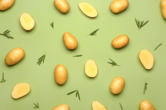 Raw potatoes on color background
