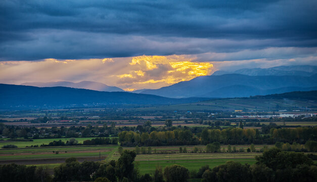View from Burgenland to mountain ridge with dramatic sky