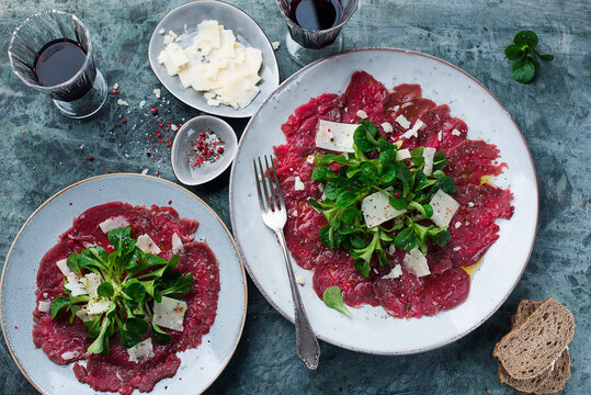 Beef carpaccio with lambs lettuce and cheese shavings