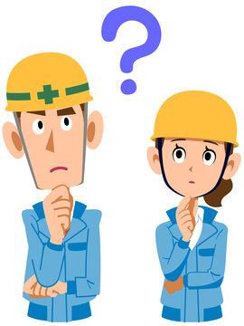 疑問を持つ建築現場作業員男女の上半身