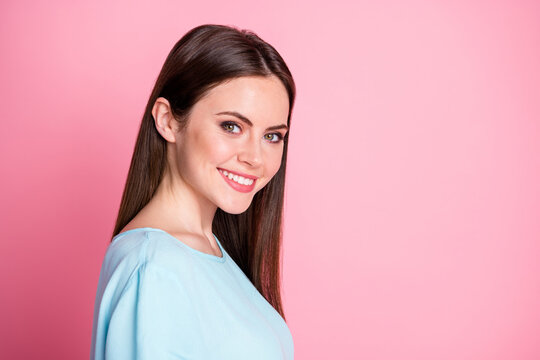 Turned photo of pretty girl look good in camera toothy smile isolated over pastel color background