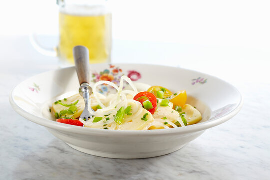 Tangy pickled Limburger cheese with onions and cherry tomatoes