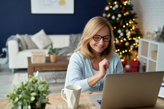 Mature woman during video conference over the holiday season