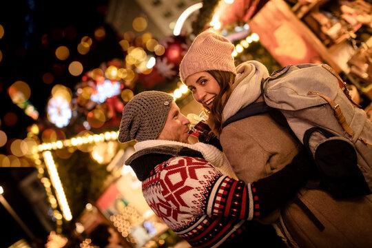 christmas couple on christmas decorated market