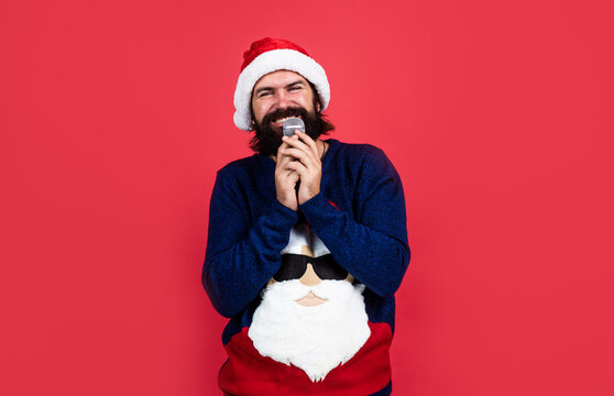 funny party time. happy winter holidays. new year mood. christmas shopping. sales and discounts. buy xmas gifts. cheerful santa man hipster sing christmas music songs. preparation and celebration
