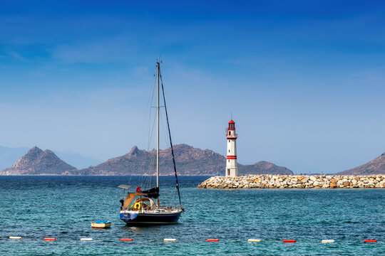 Beautiful Lighthouse and sailboat in harbor at sunny day in Bodrum, Turkey.