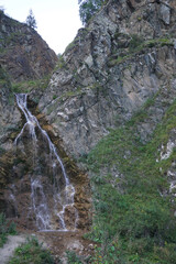 View of Caucasian mountain waterfall with glacial mineral water in Dzhily-Su tract