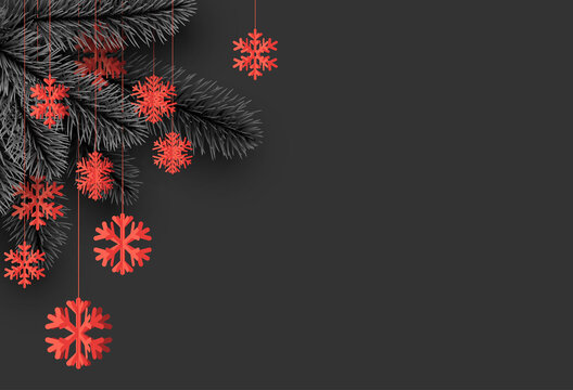 Red hanging snowflakes and spruce branches.