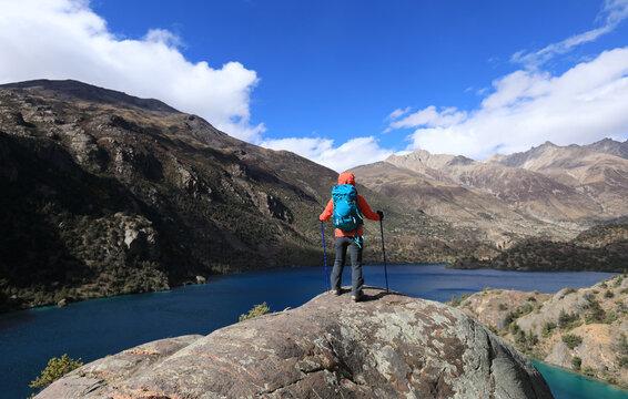 Woman backpacker hiking  in beautiful winter mountains