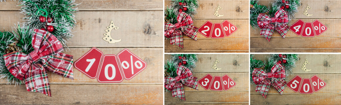 Set of 10-50 percent discount signs on a old plank background, top view, copy space. Christmas big sale.
