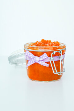 Homemade jam jar of peaches with bow