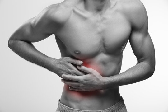 Stomach pain zone, hand pressure on abdomen
