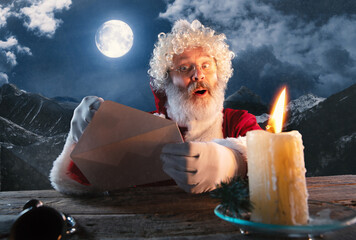 Wishes. Emotional Santa Claus congratulating with New Year 2021 and Christmas. Man in traditional...