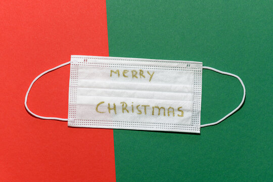 Non-medical face mask with Merry Chrismas wishes on a red green background