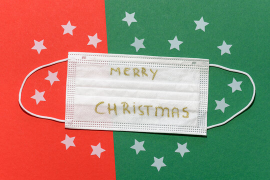 Non-medical face mask with Merry Chrismas wishes on a red green background and white stars