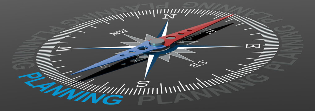 Planning word on compass with blue and red needle