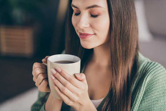 Cropped photo of dreamy girl drink coffee from home wear green shirt indoors