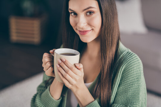 Cropped photo of optimistic girl drink coffee from home wear green shirt indoors