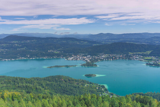 Aerial view with the alpine lake Worthersee from The Pyramidenkogel, the highest wooden viewing tower in the world, famous tourists attraction in Carinthia region, Austria
