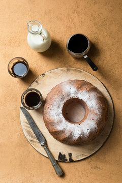 Bundt with coffee and milk top view