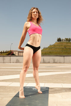 Fit girl exercising outdoor