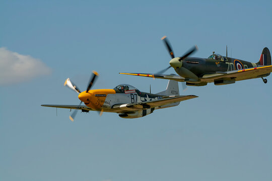 A Supermarine Spitfire and North American P-51 Mustang flying in tandem