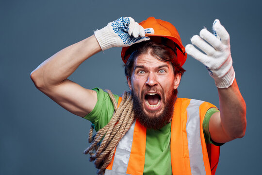 Screaming man cropped view of orange hard hat emotion professional
