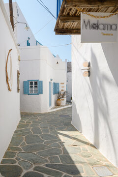 Folegandros, Greece - September 23, 2020: Cobbled street with white Cycladic architecture in Chora on Folegandros. Cyclades Islands, Greece