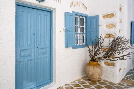 Typical Cycladic architecture, a whitewashed house with blue windows and doors. Chora, Folegandors Island, Greece