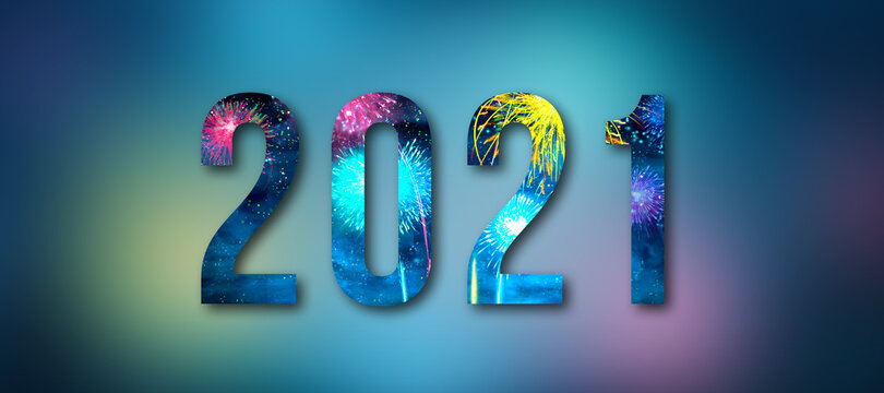message 2021 with fireworks in the letters in front of colorful background