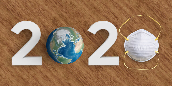 message 2020 with a globe and a face mask on wooden background