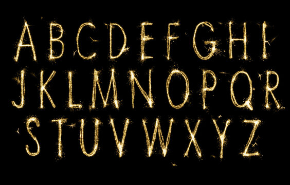 Set with letters made of sparkler on black background
