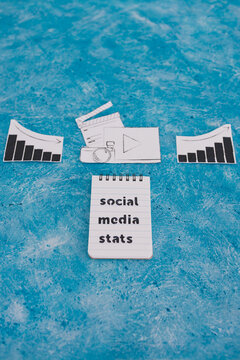 creative content and social media success, photo and video digital content icon with stats going both up and down