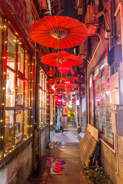 Evening view of a narrow alley in Fenghuang Ancient Town, Hunan province, China