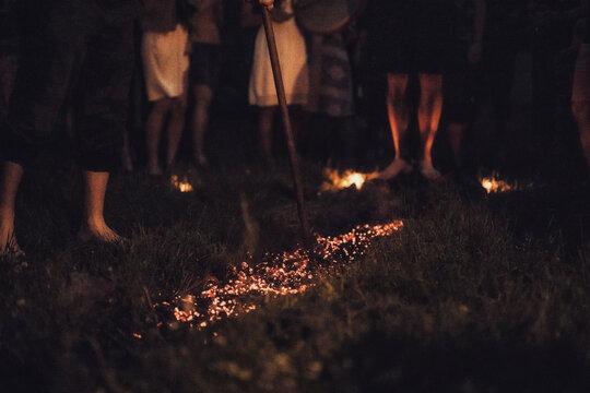 Walk on fire in night.