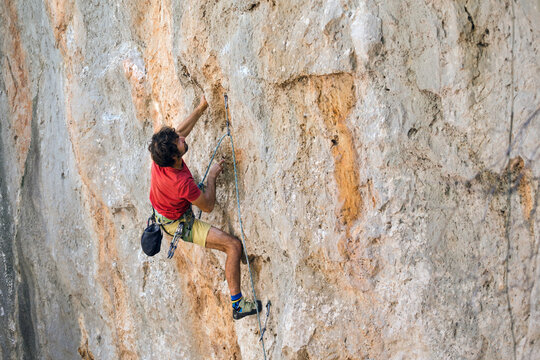 A climber is training on a natural terrain.