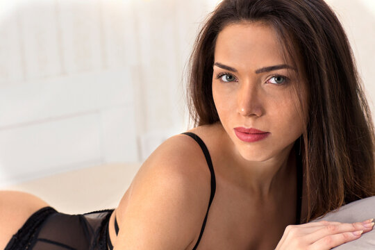 Beautiful brunette young woman posing in erotic clothes