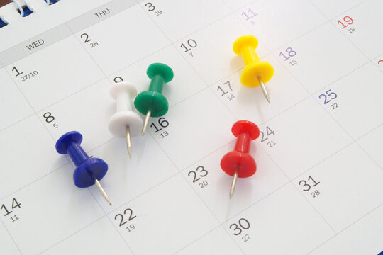 Planning concept, colorful push pins on calendar