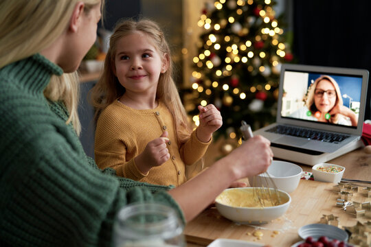 Little girl with funny face during Christmas baking with family