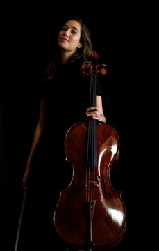 French-Belgian cellist Camille Thomas poses during an interview with Reuters at the Musee des Arts Decoratifs in Paris