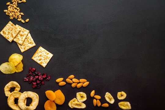 Healthy snacks overhead - nuts and dried fruits with crackers