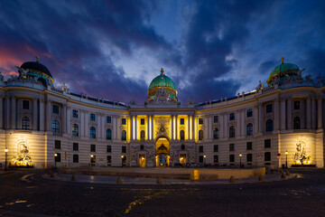 Wall Mural - Hofburg Palace.  View from Michaelerplatz, wide-angle view at night. Vienna, Austria.