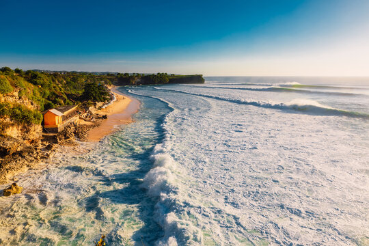 Balangan beach at Bali with big waves in ocean. Perfect waves for surfing and beach
