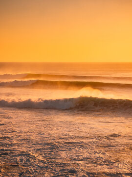Perfect waves at sunset or sunrise. Big waves for surfing in Bali